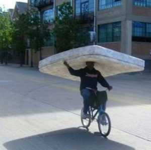 guy on bike with mattress , funny